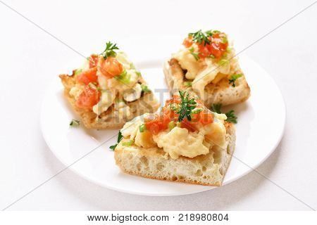 Omelette tomato green onion on bread over white background. Sandwiches with scrambled eggs and vegetables. Morning food. Snack for breakfast