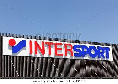 Saint Bonnet de Mure, France - June 18, 2017: Intersport logo on a facade. The Intersport Group is an international sporting goods retailer