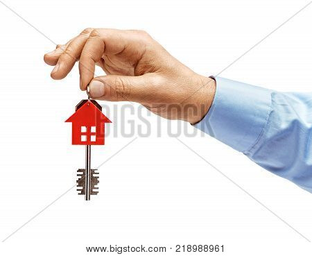 Man's hand in shirt holding house keys isolated on white background. High resolution product. Close up.