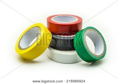 Adhesive insulation tapes are isolated on a white background. Colorful insulating tape on white background. Rolls of insulation  multicolored tape.