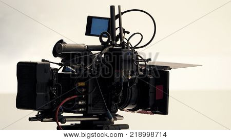 4K high defination video camera with tripod shooting in studio production and no people.