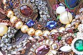 Fashion jewelrys. Fashion jewels as background. Jewelery texture. A lot of Jewells in texture. Jewellery background. Beautiful jewels pattern.Necklace pearls. poster