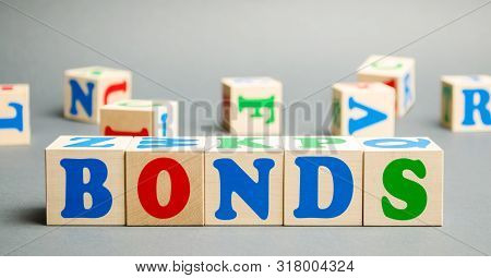 Wooden Blocks With The Word Bonds. A Bond Is A Security That Indicates That The Investor Has Provide