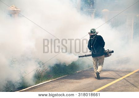 Man Use Fumigation Mosquitoes Machine For Kill Mosquito Carrier Of Zika  And Dengue Fever Around The