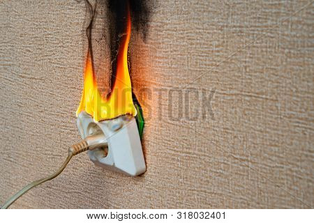 Burning Electrical Wiring And Electrical Outlet. Faulty Wiring Causes Fires. Poor Old Wiring Causes