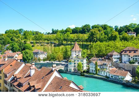 Beautiful Cityscape Of Swiss Capital Bern. Old Town Located Along Turquoise Aare River. Historical B