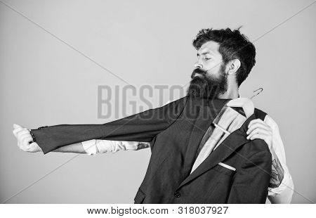 At Tailor House. Master Tailor. Bearded Man Measuring Sleeve Length Of Suit Jacket In Tailor Shop. H