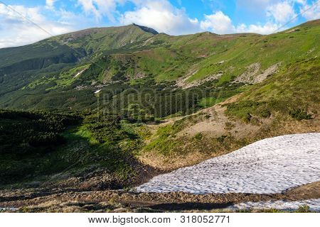 Massif Of Pip Ivan With The Ruins Of The Observatory On Top. And Remnants Of Melting Snow In Valley,