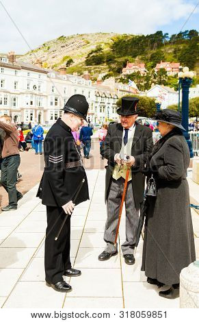 Llandudno, North Wales- 29th April 2017: Three People Dressed In Victorian Costumes In Llandudno As
