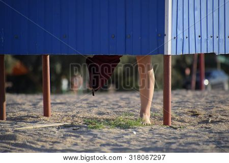 Dressing Room On The Beach, Girls Legs Are Visible From The Dressing Room, The Girl Changes Clothes