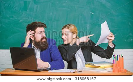 Concentrated On Studying. Teacher And Student On Exam. Business Couple Use Laptop Documents. Busines