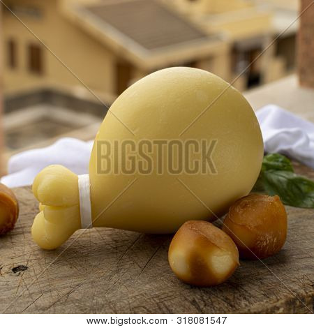 Italian Provolone Caciocavallo Aged And Smoked Cheeses In Teardrop Form With Yellow Houises Of Old I