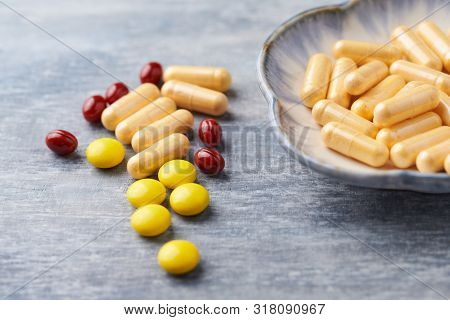 Beta-carotene, Vitamin C Tablets And Coenzyme Q10 Capsules. Antioxidants. Concept For A Healthy Diet