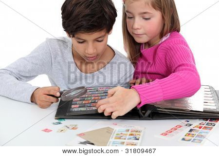 Children looking at a stamp album poster