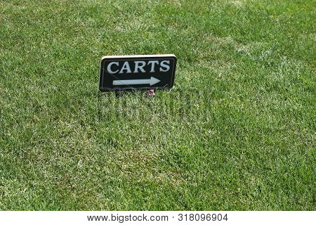 This Is An Image Of A Golf Course Directional Sign.