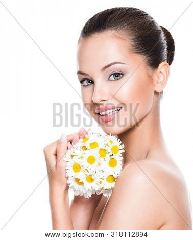 Smiling face of young beautiful woman holds a posy flowers - isolated on white background
