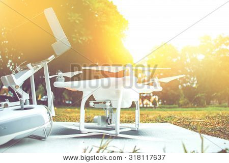 White Camera Drone Standby For Take Video In Tv Documentary Beside With Remote Controller