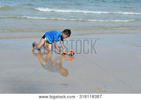 Hin Ngam Beach, Nakhon Si Thammarat Province, Thailand -13 April 2019: Asian Boys Playing In The Sea