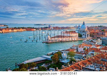 Aerial view of Venice lagoon and Santa Maria della Salute church on sunset. Venice, Italy