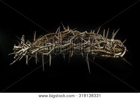 Crown of thorns with dramatic light isolted over dark background