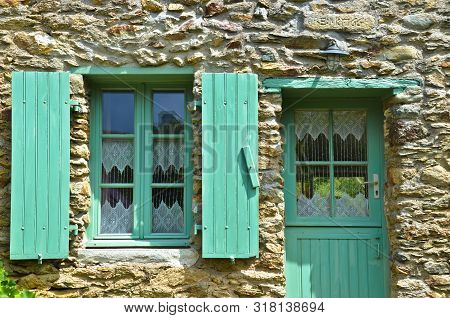 Sunny View Of A Windows Of An Old Farm House With Green Shutters, Where A Curtain Of Handmade Croche