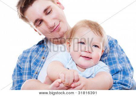 studio picture of smiley father and son. white background