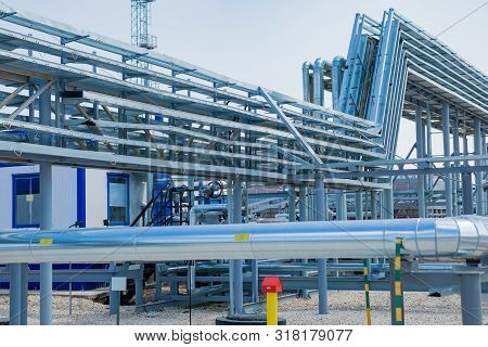 Industrial Zone,the Equipment Of Oil Refining,close-up Of Industrial Pipelines Of An Oil-refinery Pl