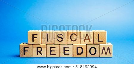Wooden Blocks With The Word Fiscal Freedom. Tax Burden Imposed By Government. Taxation. Taxes Concep
