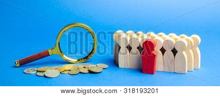 Coins, Magnifying Glass And A Team Of Employees. Business Valuation Concept - Process Of Determining