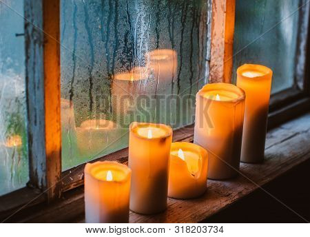 Beautiful Background With Raindrops On The Window And Burning Candles. Twilight Rainy Summer Or Autu