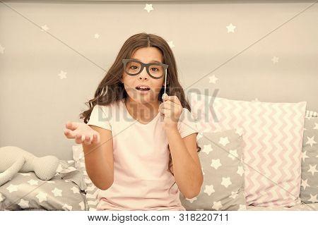Slumber Party Photo Booth Props. Kid Girl Wondering Posing With Vintage Eyeglasses Party Attribute.