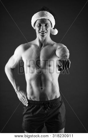 Sexy athletic macho in santa claus hat. If you were very bad girl. Macho sexy muscular torso posing confidently. Santa claus comes not only to good girls. Athlete man wear santa hat and red shorts. poster