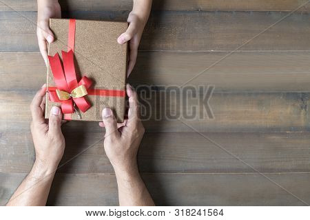 Daughter Holding Dad's Hands Giving Present Gift Box