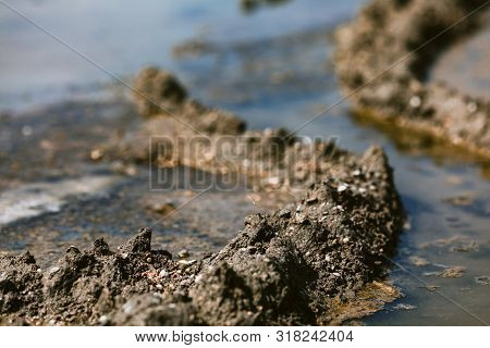 Therapeutic mud clay black for background. healing mud poster