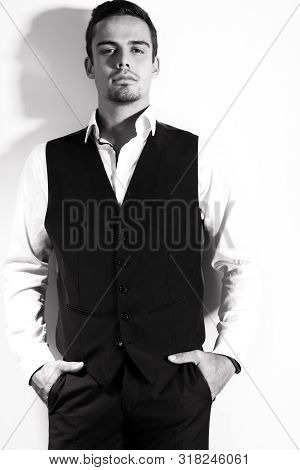 Portrait Of Handsome Man With Goatee Isolated Against White Wall.