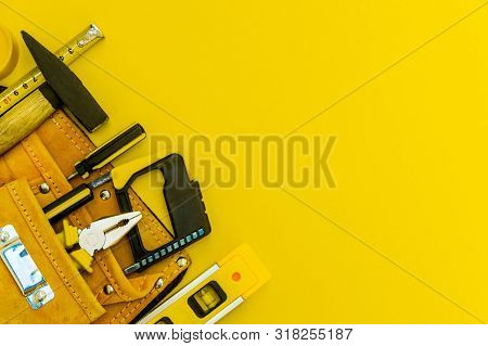 Professional tools for the joiner and spare parts.. Set for the master on yellow background. poster