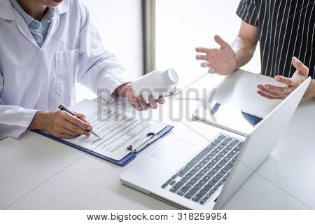 Doctor Presenting Report Of Diagnosis, Symptom Of Disease And Recommend Something A Method With Pati