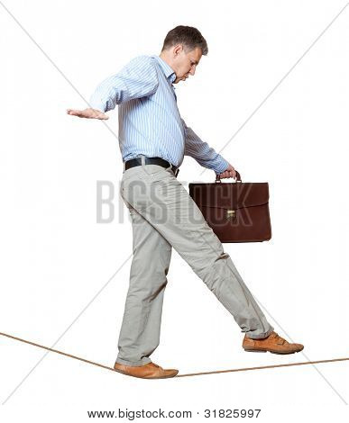 Businessman rope-walker. Isolated on white background poster