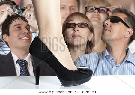 Fashion show. Spectators on demonstration of fashionable footwear