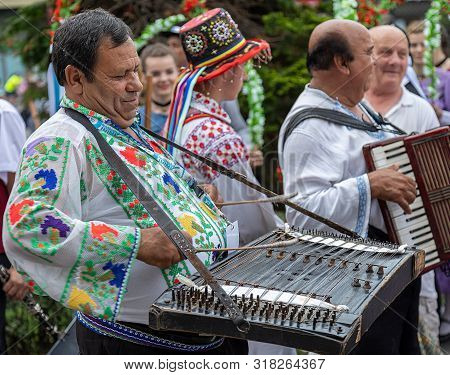 Romania, Timisoara - July 4, 2019: Singers Men At Cimbalom And Acordeon From Romania In Traditional