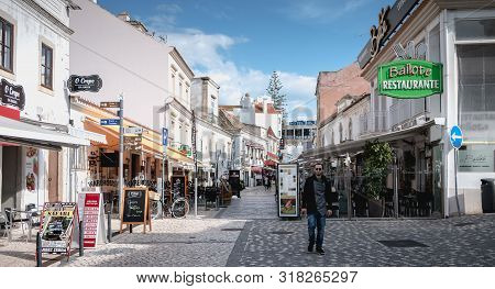 Street Atmosphere And Souvenir Shop Architecture And Restaurants In Albufeira, Portugal
