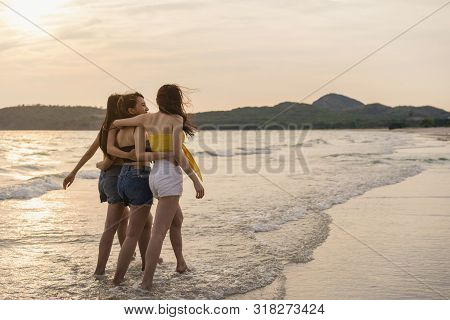 Group Of Three Asian Young Women Walking On Beach, Friends Happy Relax Having Fun Playing On Beach N