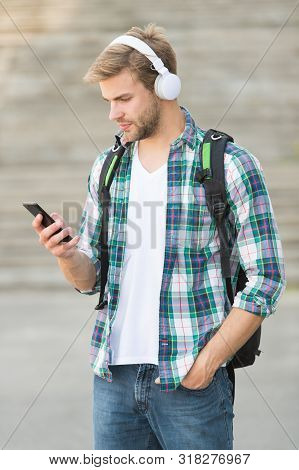 E Learning. College Student Headphones Smartphone. Online Learning. Audio Book Concept. Educational