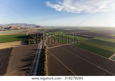 Aerial view of farm fields and Santa Monica Mountains hilltops near Camarillo in Ventura County, California.