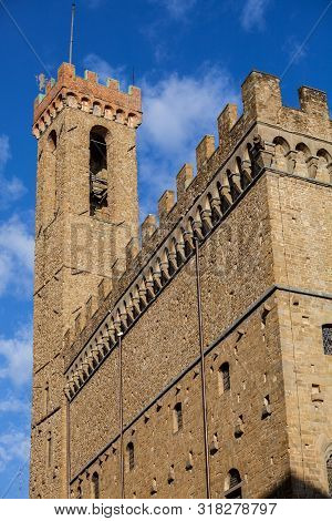The Palazzo Vecchio (old Palace) Is The Town Hall Of Florence, Italy. Detail Of The Tower And The Wa