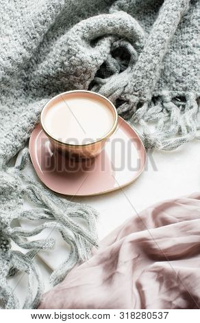 Beautiful Enameled Cup Of Coffee With Pink Silk And Knitted Blanket