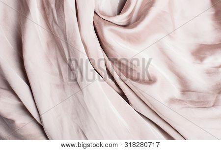 Beautiful Beige Texture Of Folded Silk Cloth