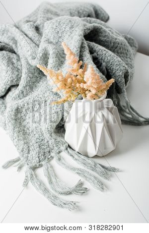 Small Bouquet Of Flowers In Vase With Blanket