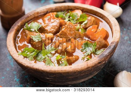 Hungarian goulash, pork or beef stew served in round bowl