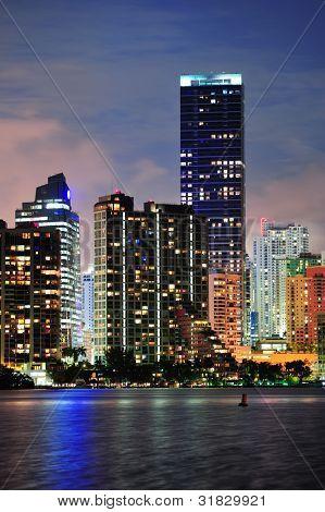 Miami urban architecture closeup over sea at night.